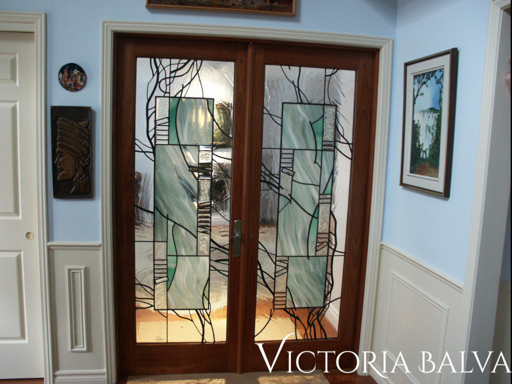 Modern wooden interior double doors with contemporary stained and leaded glass design
