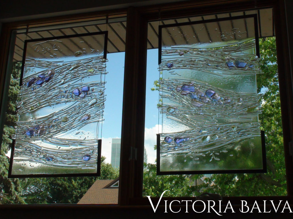 Contemporary abstract kiln cast glass for a landing to add privacy and beauty