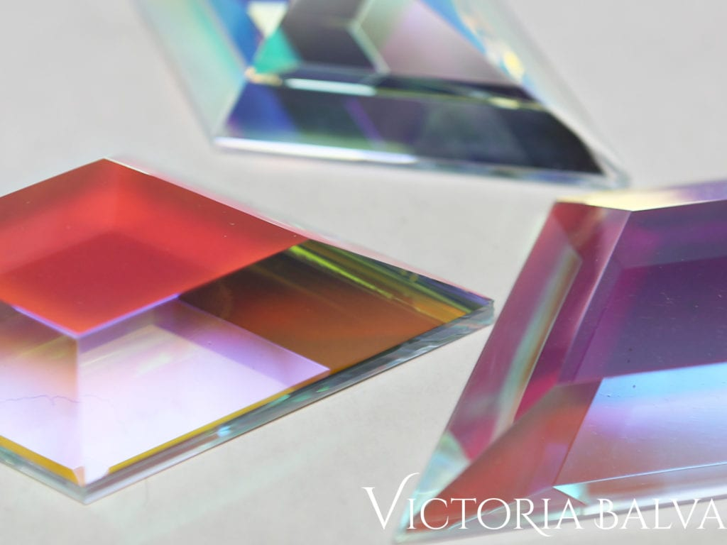 Laminated dichroic custom bevelled glass samples with powerful color reflection