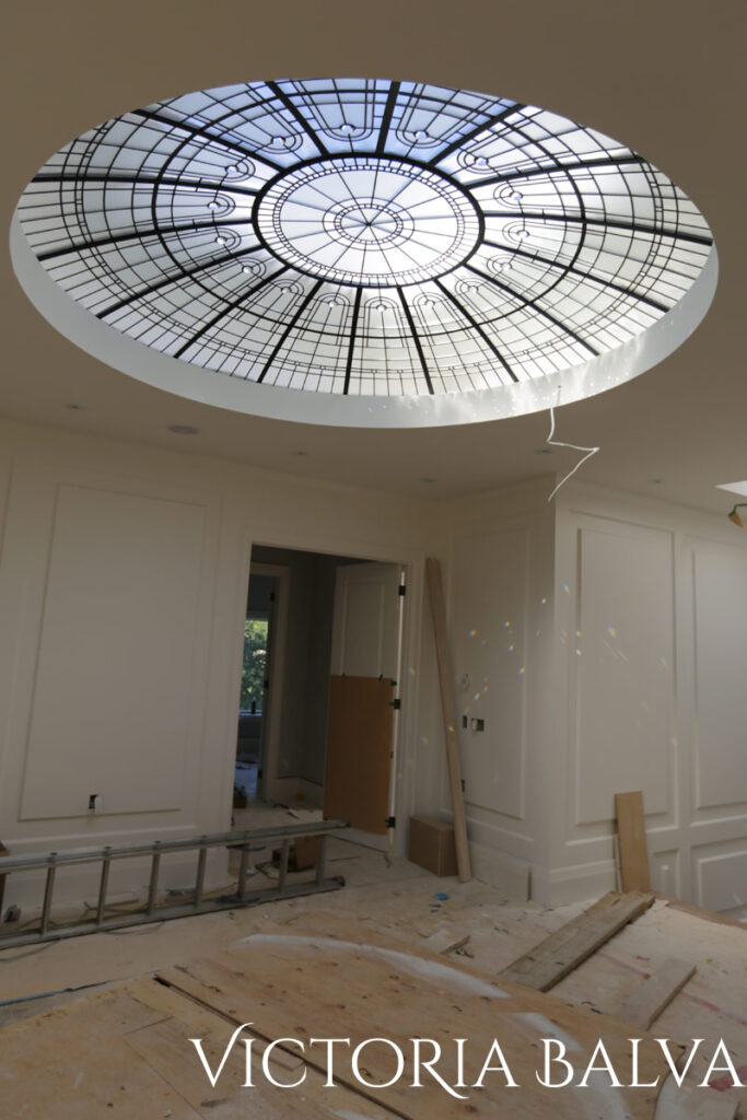 Large 10 feet diameter stained and leaded glass dome in simple geometric design for a hallway of a custom built residence in Los Angeles