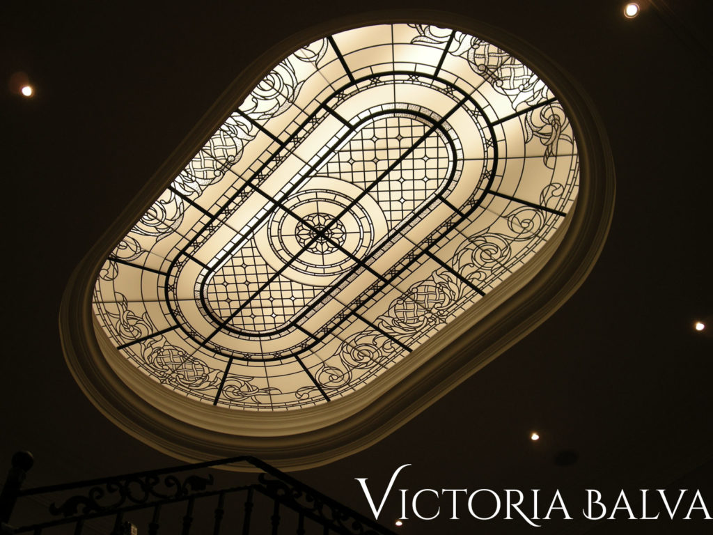 Racetrack oval stained and leaded glass laylight for a stairwell of a custom built house in Toronto