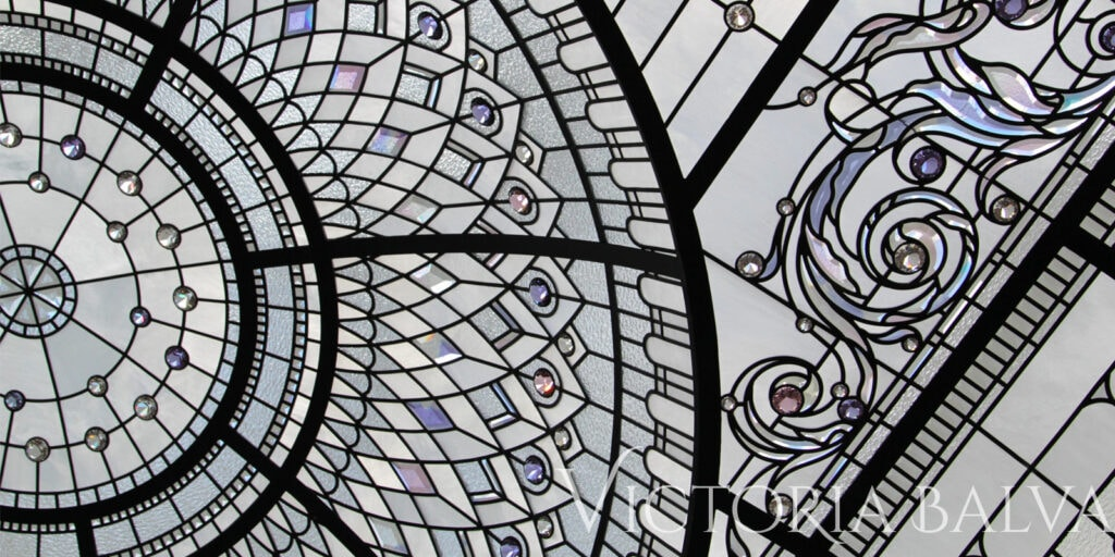 Beatifully designed stained and leaded glass dome ceiling with custom hand bevelled glass for a double height entrance foyer