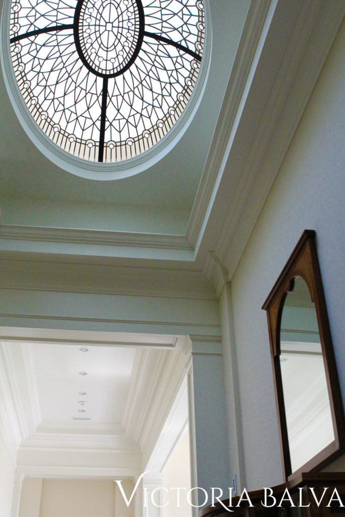 Hallway with oval glass ceiling lay light for a custom built house