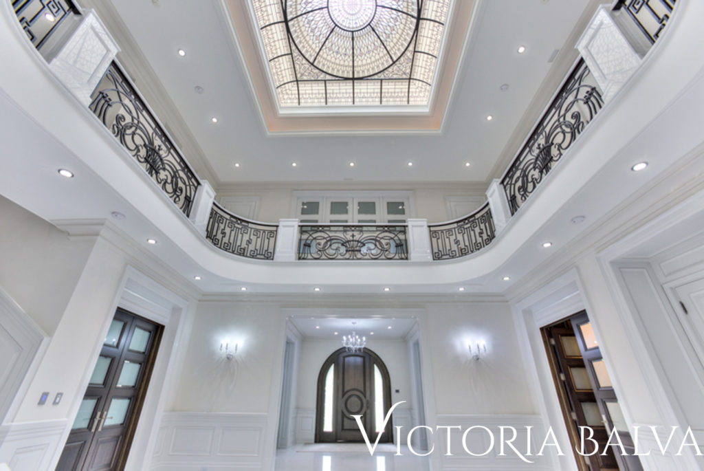 Atrium foyer with stained glass dome skylight for a luxury custom built residence in Toronto