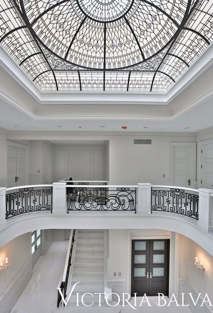 Double-height entrance foyer of a custom built house in Toronto with leaded glass dome ceiling