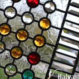 Contemporary abstract door light design with clear bevelled glass and colored jewels