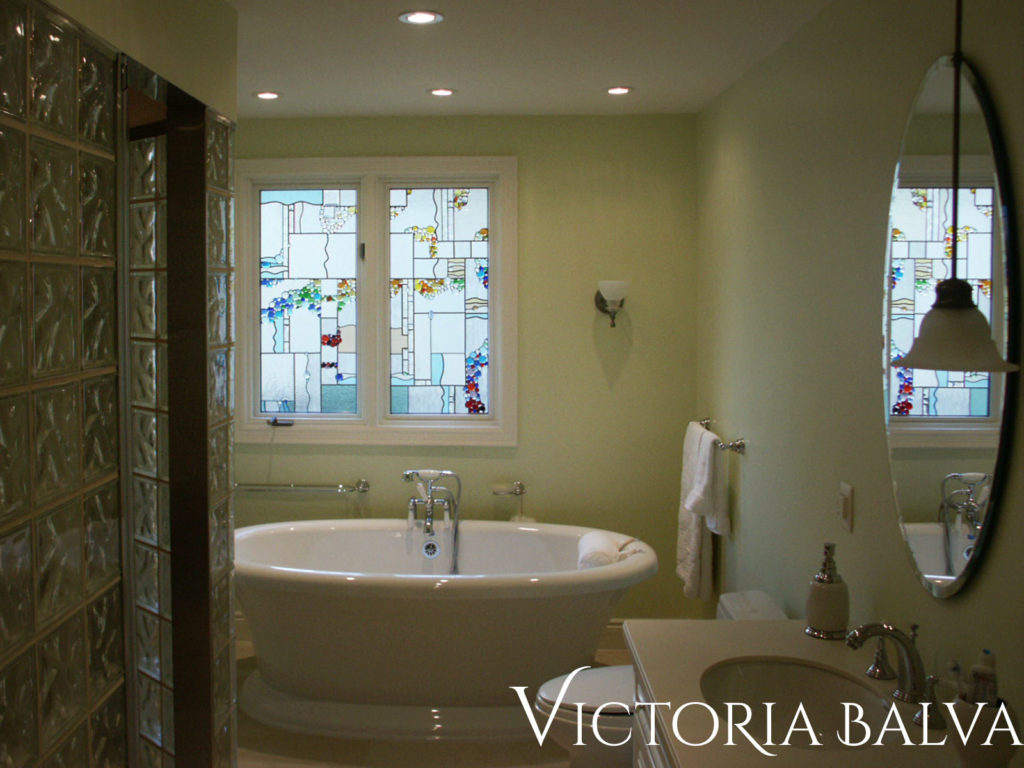 Bathroom with stained and leaded glass window to add beauty and privacy to space