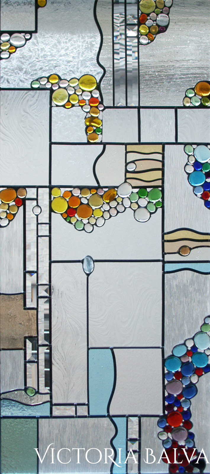 Contemprorary abstract stained, beveled and leaded glass windows detail with globes and beveled glass