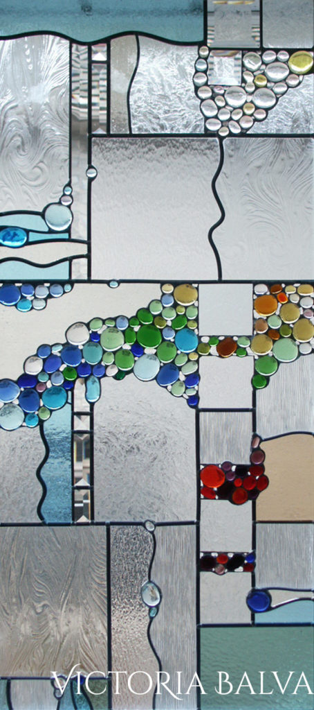 Contemporary abstract stained and leaded glass window with colourful globes and bevelled glass