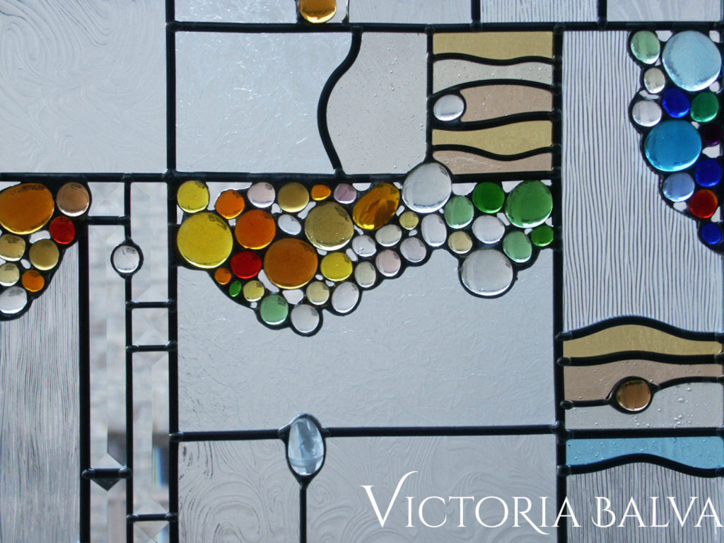 Contemporary style art glass panel with bevelled glass