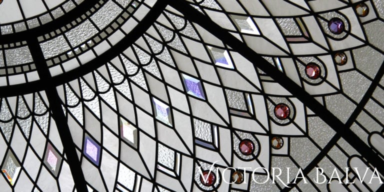 Classically modern elegant stained glass dome with colored hand bevelled glass and crystal jewels for a custom built house in New York