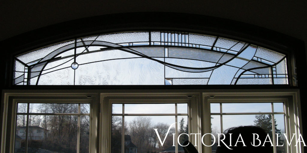 Contemporary stained glass for odd shaped window transom with clear textured glass, bevelled glass and crystal stained glass jewels