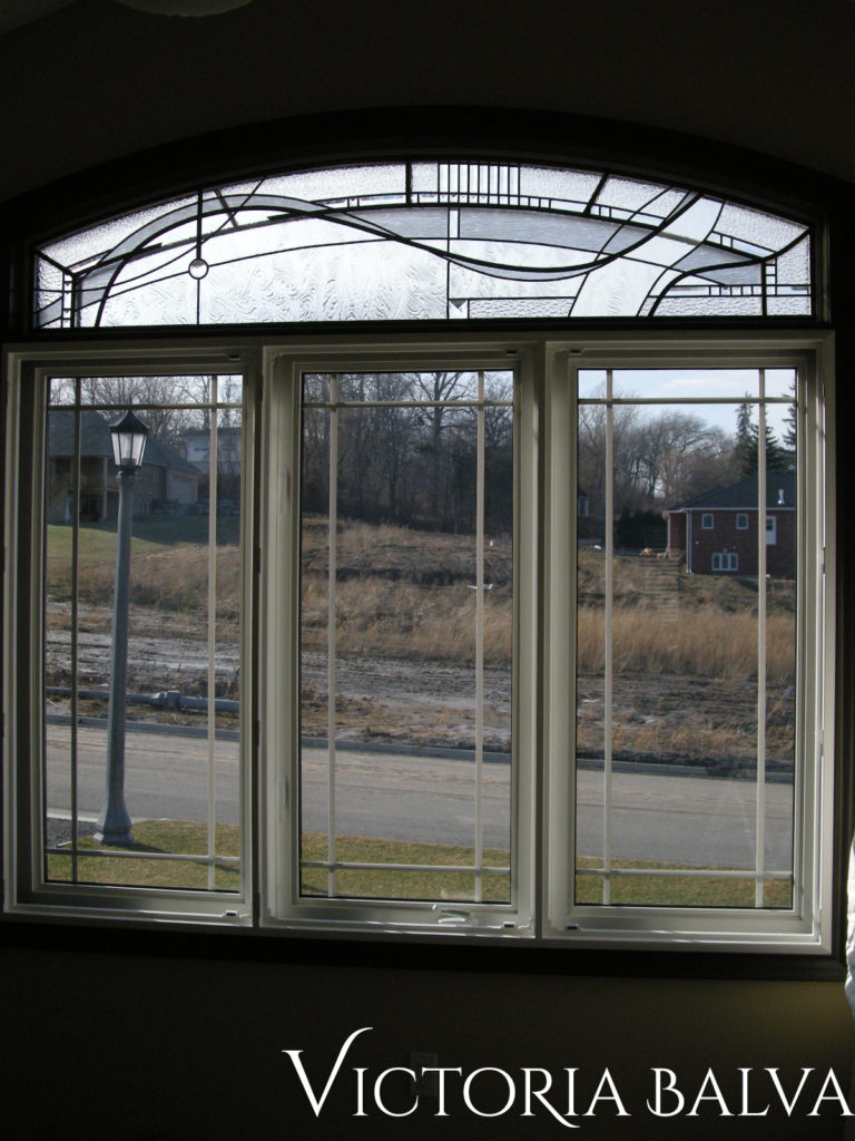 Bedroom window with contemporary stained and leaded glass transom