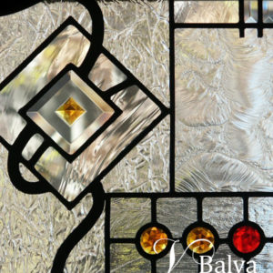Contemporary stained and leaded glass window in geometrical abstract style with colored crystal jewels and custom hand bevelled glass