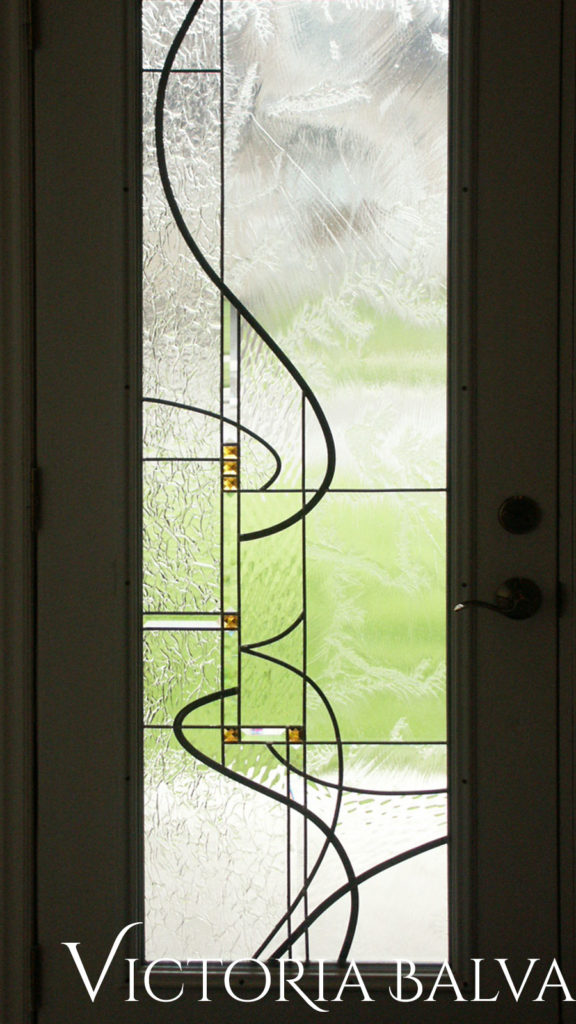 Contemporary simple stained glass design for a double door entrance system