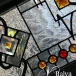 Abstract modern stained glass window transoms with amber and red stained glass jewels for a living room of a custom built residence in Forest Hill Toronto