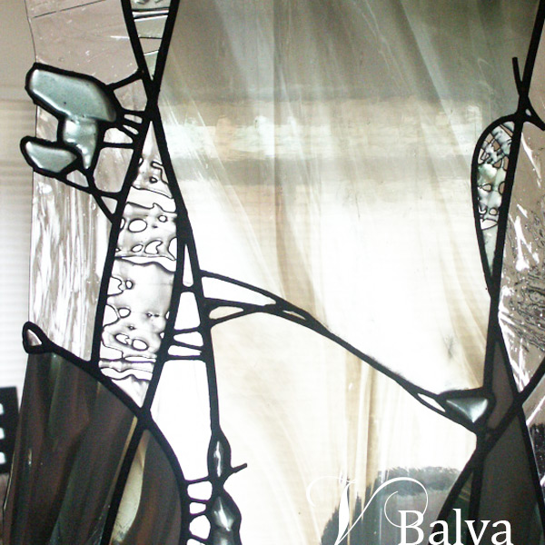 Stained and leaded glass wall divider with fused elements