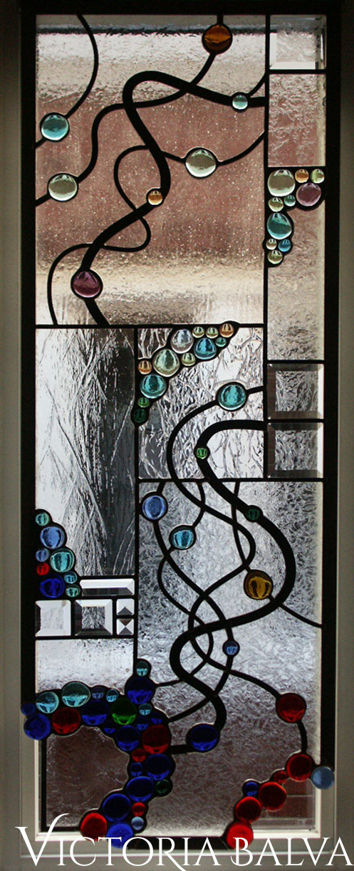 Abstract style stained, beveled and leaded glass free shape suspended panels with nuggets and beveled glass