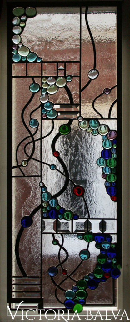 Modern abstract stained and leaded glass hanging with bevelled glass and colorful glass globes
