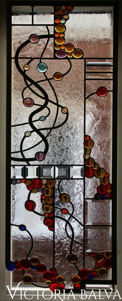 Contemporary stained glass hanging with bevelled glass, clear textured glasses and bright colorful glass nuggets