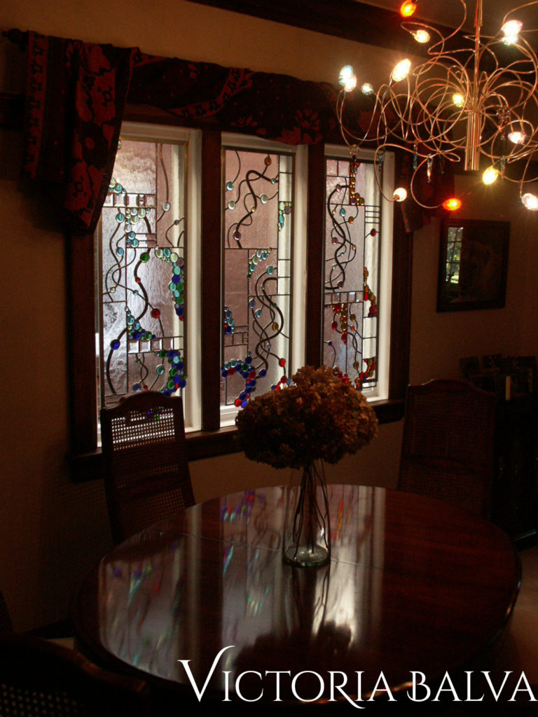 Modern stained and leaded glass hanging panel for the dining room inspired by spiral wires chandelier