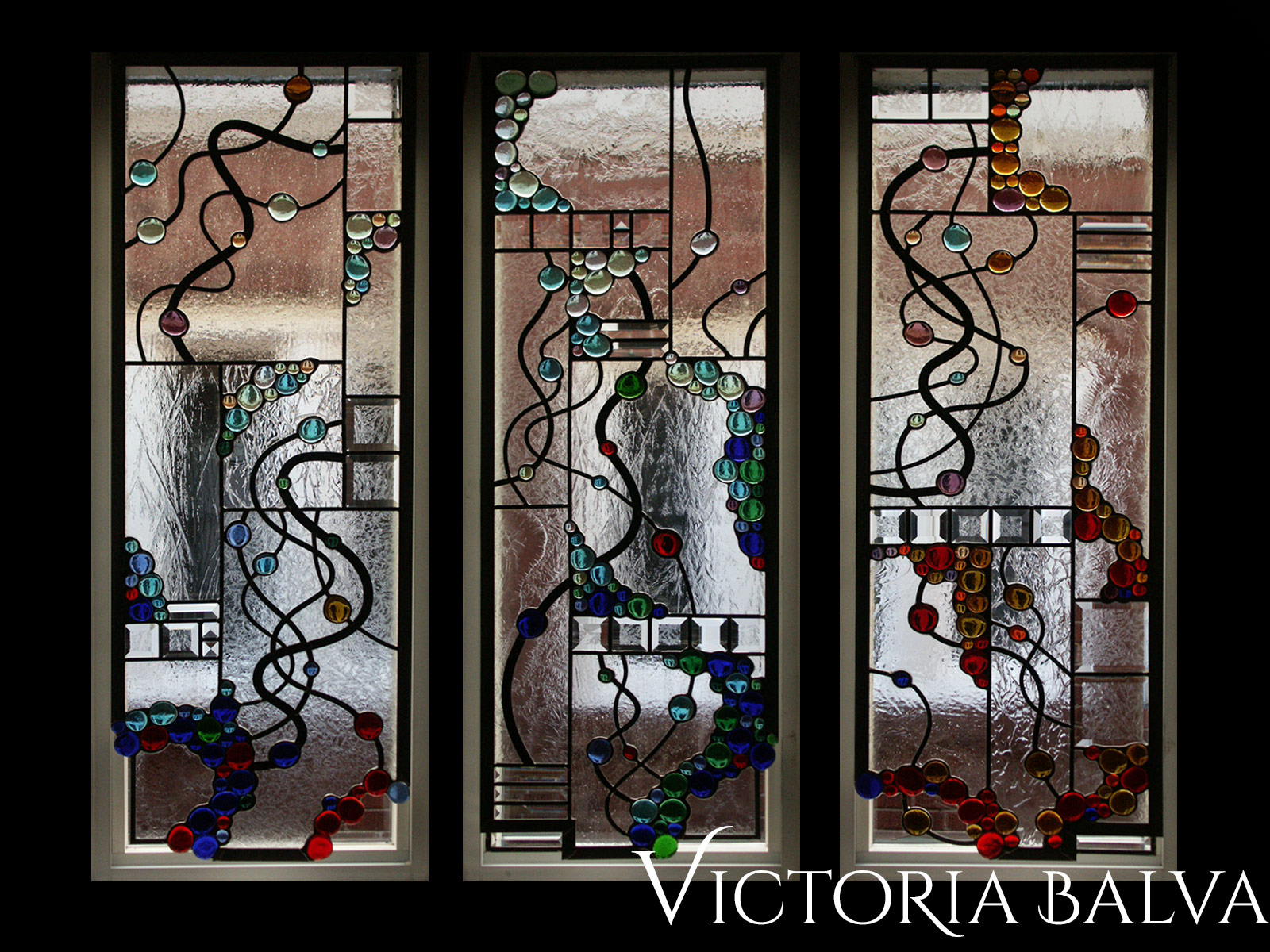 Modern style stained, beveled and leaded glass free shape suspended panels with nuggets and beveled glass