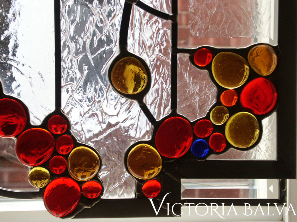 Modern stained and leaded glass panel edge with glass nuggets and bevelled glass