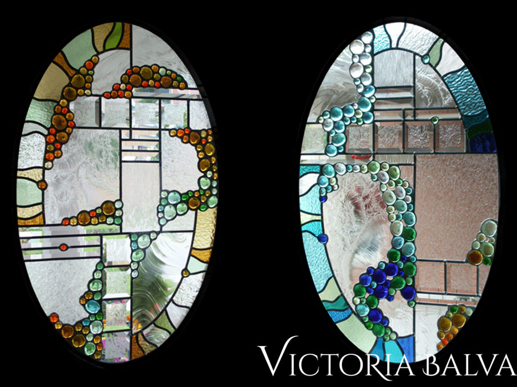 Stained and leaded glass oval windows in contemporary abstract style with glue chip beveled glass and nuggets