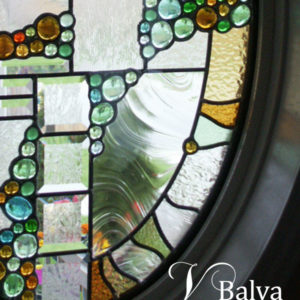 Modern design stained and leaded glass oval window for a front entrance foyer of the house in Richmond Hill
