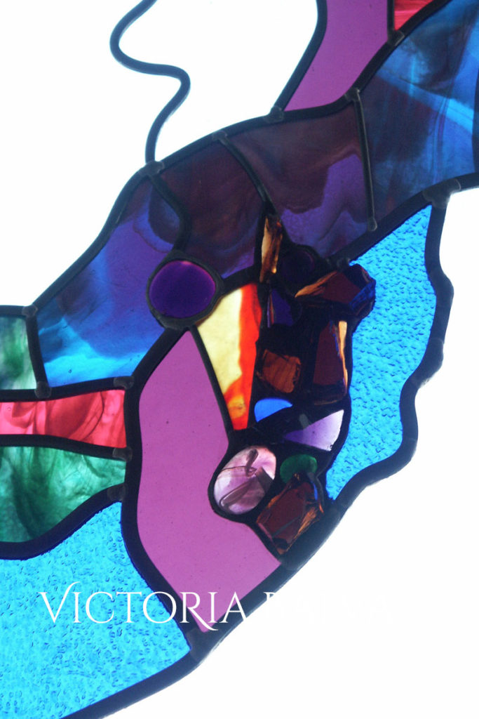 Contemporary flued geometrical design in stained glass