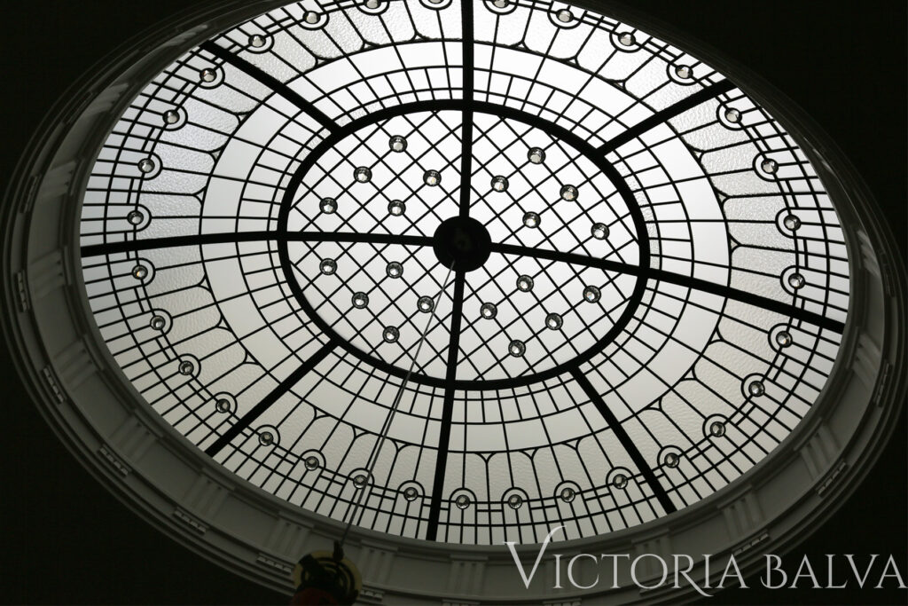 Ellipse stained and leaded glass dome with crystal jewels in simple design for an oval staircase