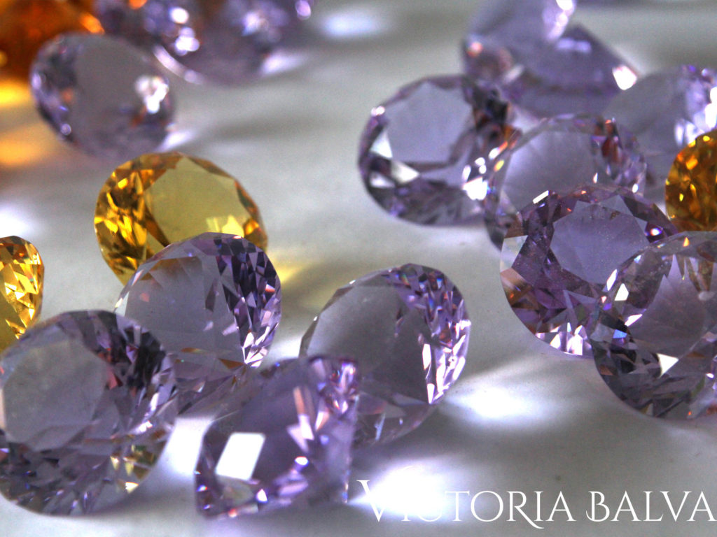 Amber and lilac accent jewels for a stained and leaded glass window