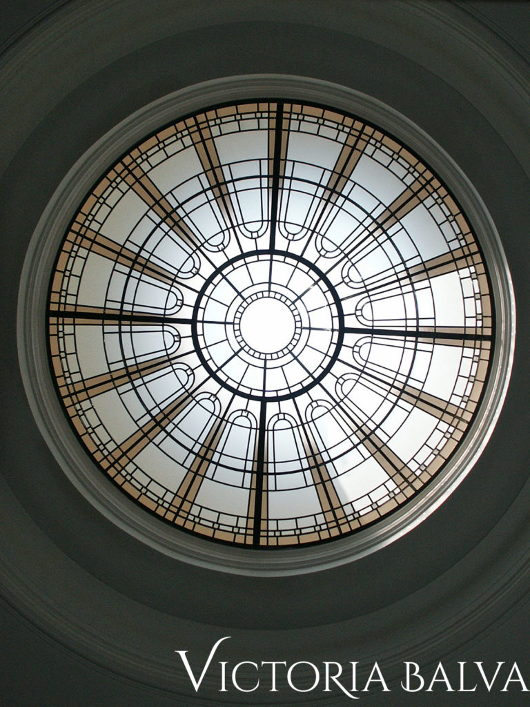 Traditional stained and leaded glass circular skylight for the hallway of a custom built residence in Toronto