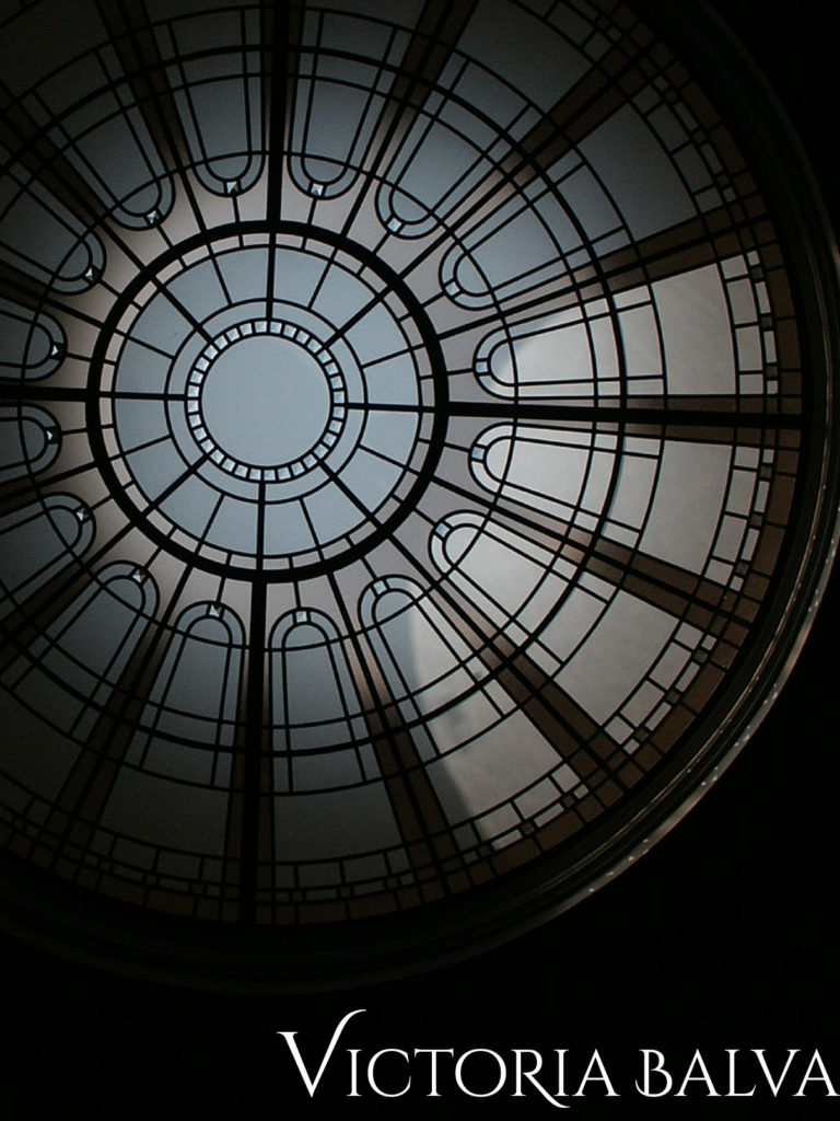 Round stained and leaded glass ceiling with delicate colours of architectural textured glass and bevelled glass