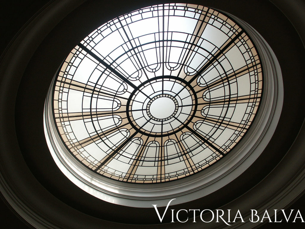 Clear and pale textured glass circular glass ceiling for custom built residence in Toronto