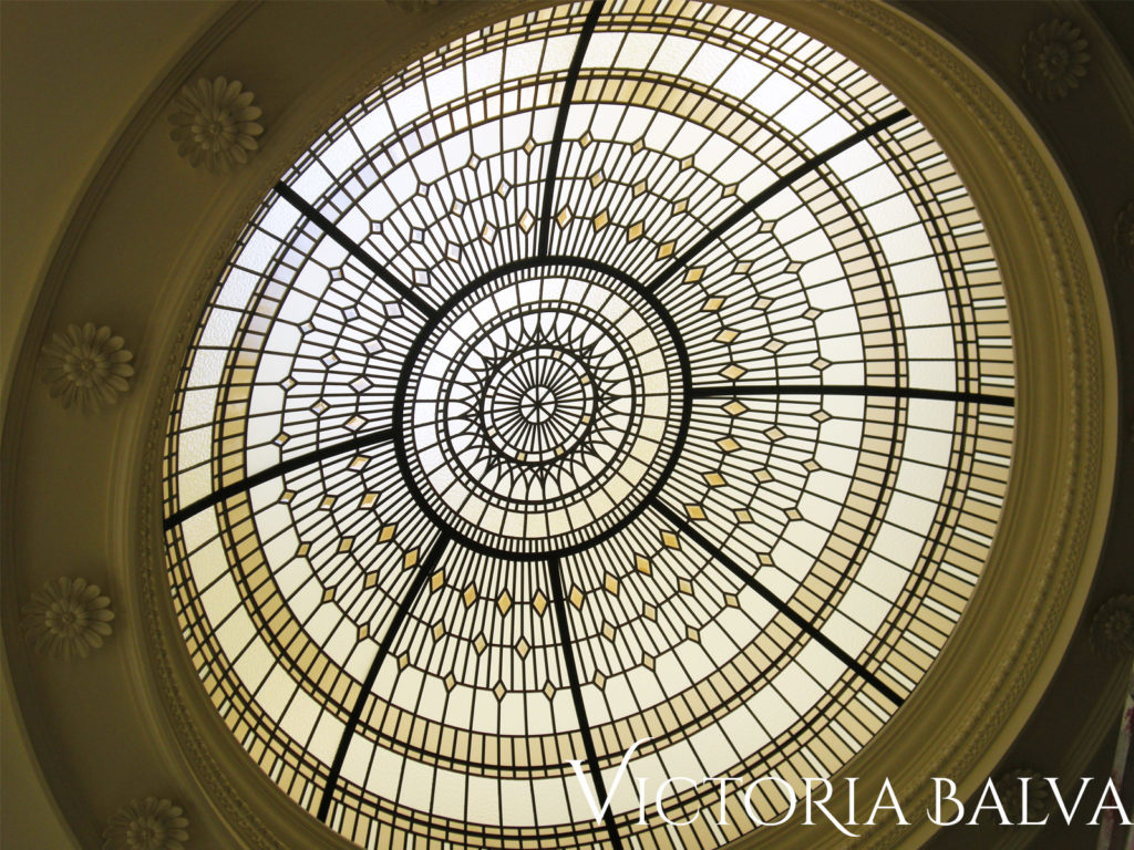 Stained and leaded glass dome with bronze textured glass and tinted bronze bevels