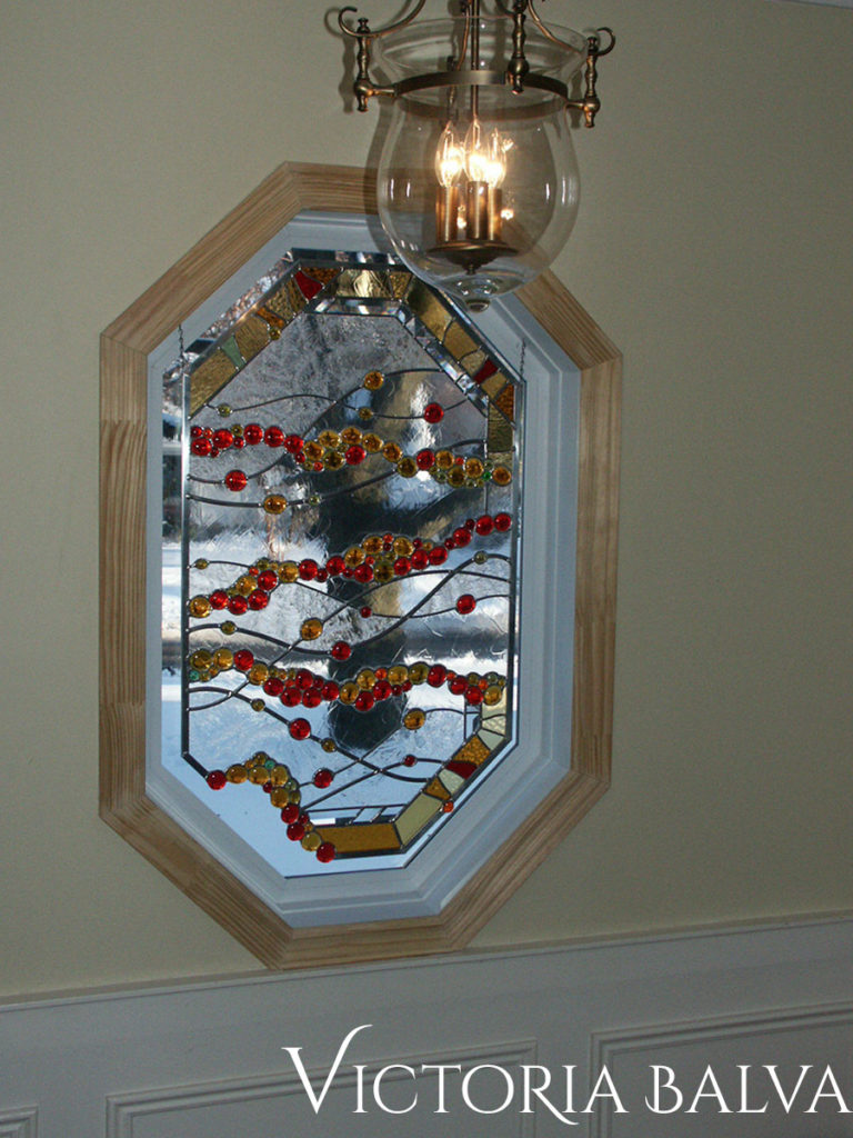 Contemporary modern stained and leaded glass window octagon shape with bevelled glass, jewels, bevelled glass and bright glass nuggets