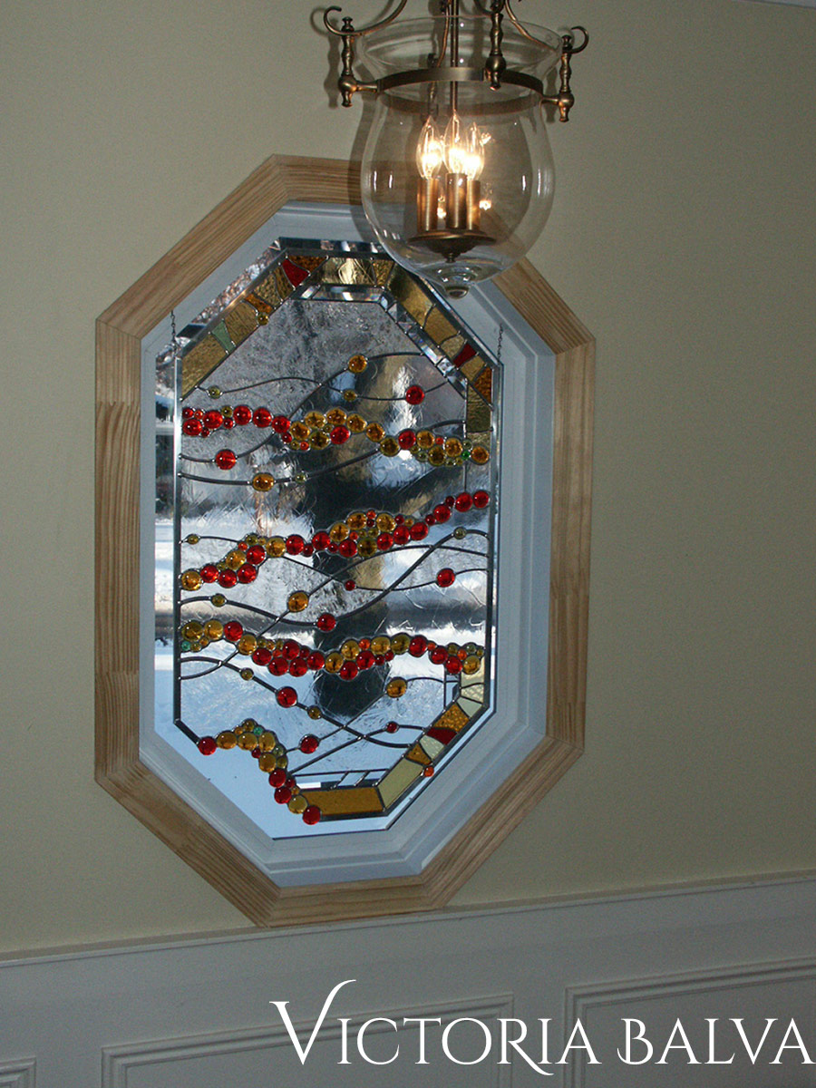 Contemporary design stained leaded glass octagon window with globes, tsunami glue chip and beveled glass for the foyer of a private residence