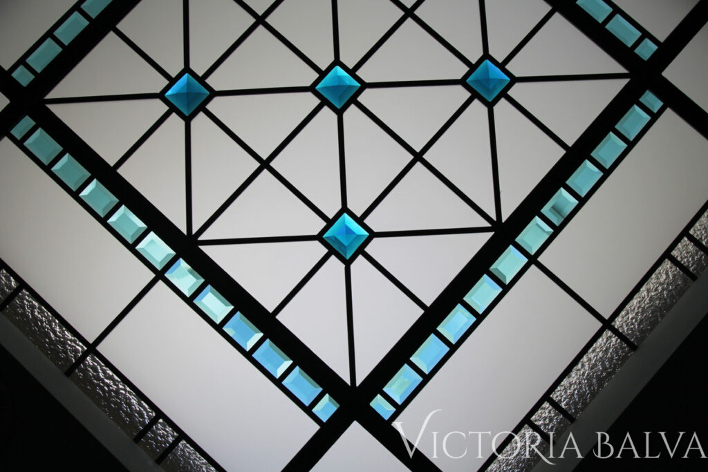 Clear textured small octagon skylight with turquoise bevelled glass and blue stained glass jewels