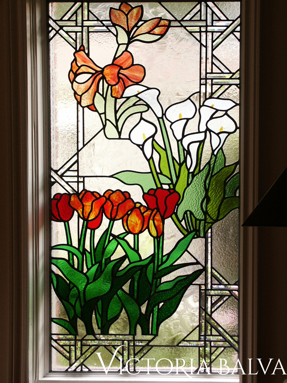 Stained and leaded glass window. Flower garden. Amoralis, Tulips, Lilias. Overall view of the window