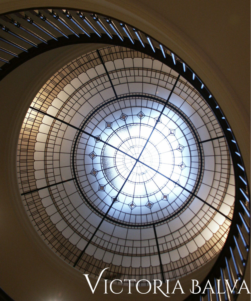 Large stained and leaded glass dome for a double-height foyer of a custom built residence in Hogg's Hollow, Toronto by Merit Homes Inc