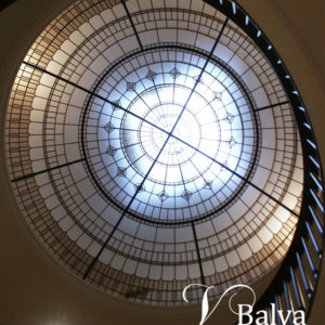 Stained glass dome with bronze accent glass and clear bevelled glass for a double-height foyer of a luxury custom-built house in Hoggs Hollow