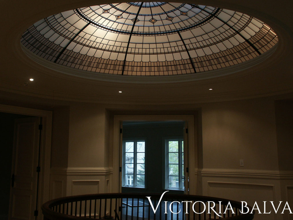 Second floor circular hallway with stained glass dome in simple geometrical design