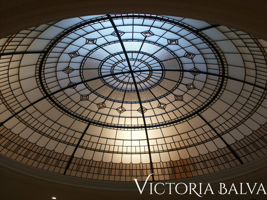 Stained glass dome with simple geometrical pattern and large crystal jewels by Merit Homes Inc