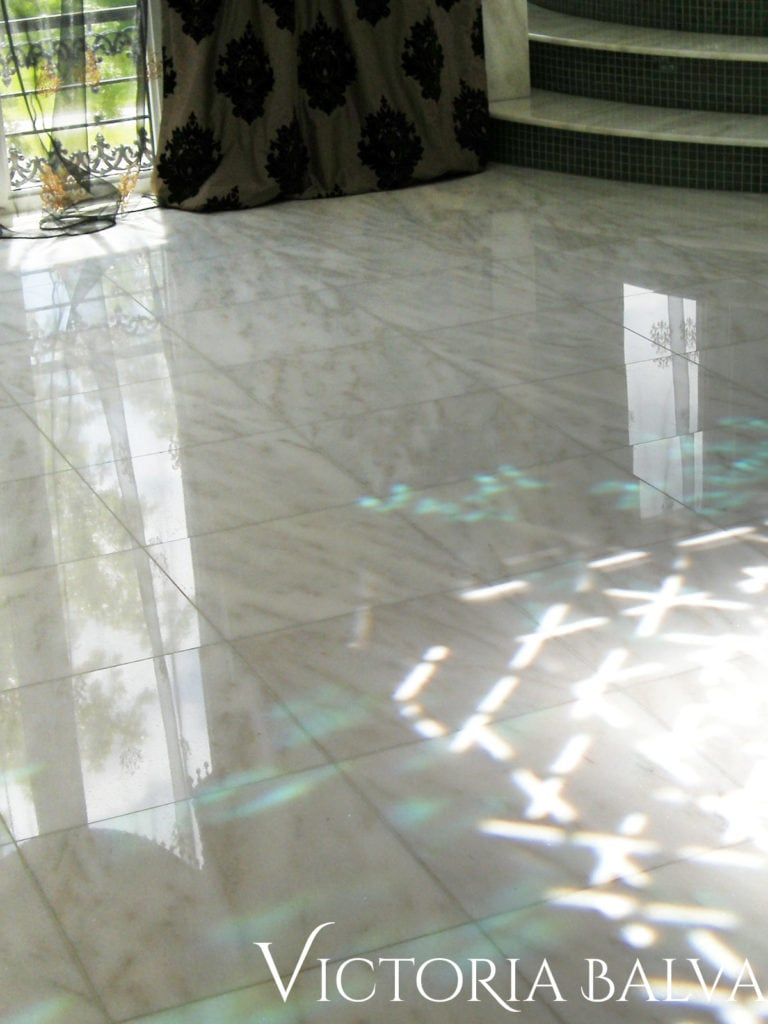 light reflections on the master bathroom marble floor