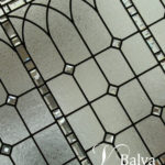 Classic stained and leaded glass window with bevelled glass for a stair landing of a custom built residence in Toronto