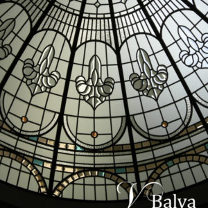 Classically modern stained leaded glass dome with clear textured glass granite, acid etched, colored clear and bevelled glass for double height entrance foyer