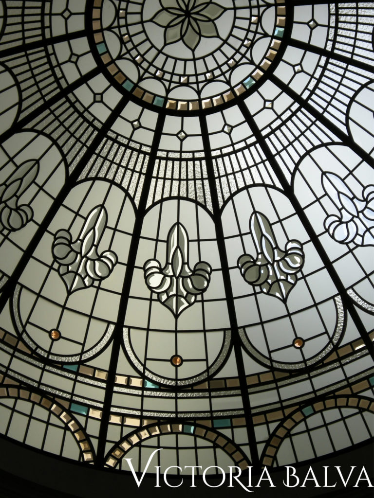 Stained and leaded glass dome with coloured and clear bevelled glass and bevelled glass clusters