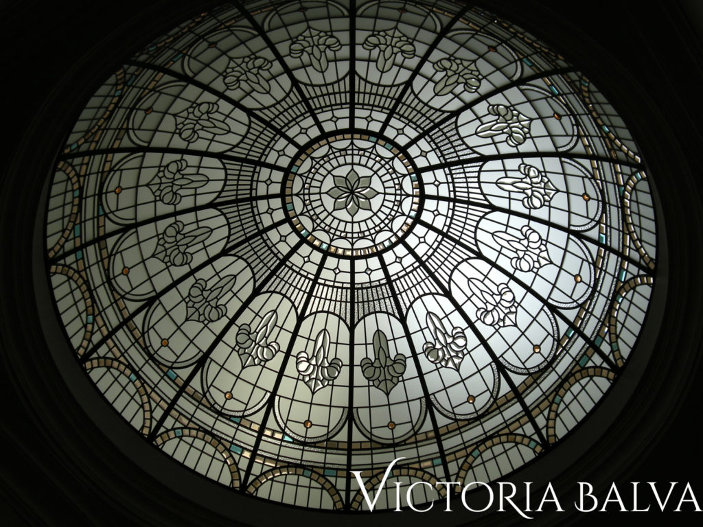 Dramatic stained and leaded glass dome with clear textured and beveled in a double-height entrance foyer of a custom-built house in New York