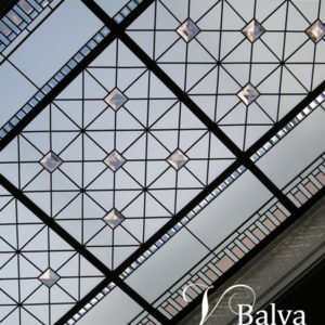 Classic elegant stained and leaded glass skylight ceiling with coloured bevelled glass and large crystal jewels